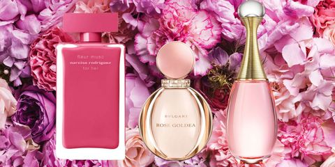 Perfume, Pink, Product, Cosmetics, Magenta, Material property, Glass bottle, Rose, Bottle, Flower,