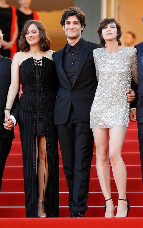 <p>Marion Cotillard in Jean Paul Gaultier Couture, Louis Garrel eCharlotte Gainsbourg in Saint Laurent</p>