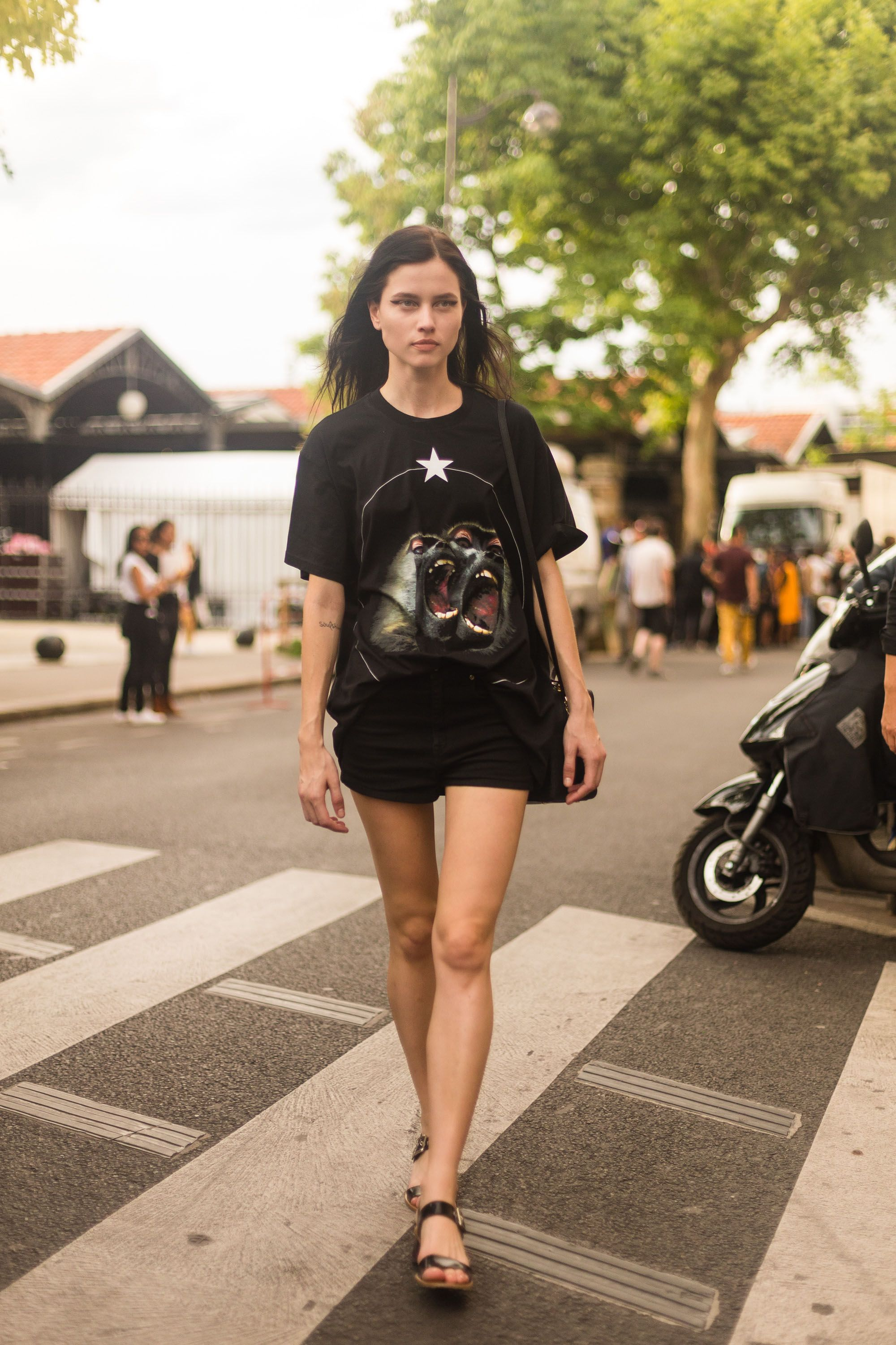 PARIS, FRANCE - JUNE 26:  Model Isis Bataglia exits the Givenchy show in a Givenchy t-shirt on June 26, 2015 in Paris, France.  (Photo by Melodie Jeng/Getty Images)