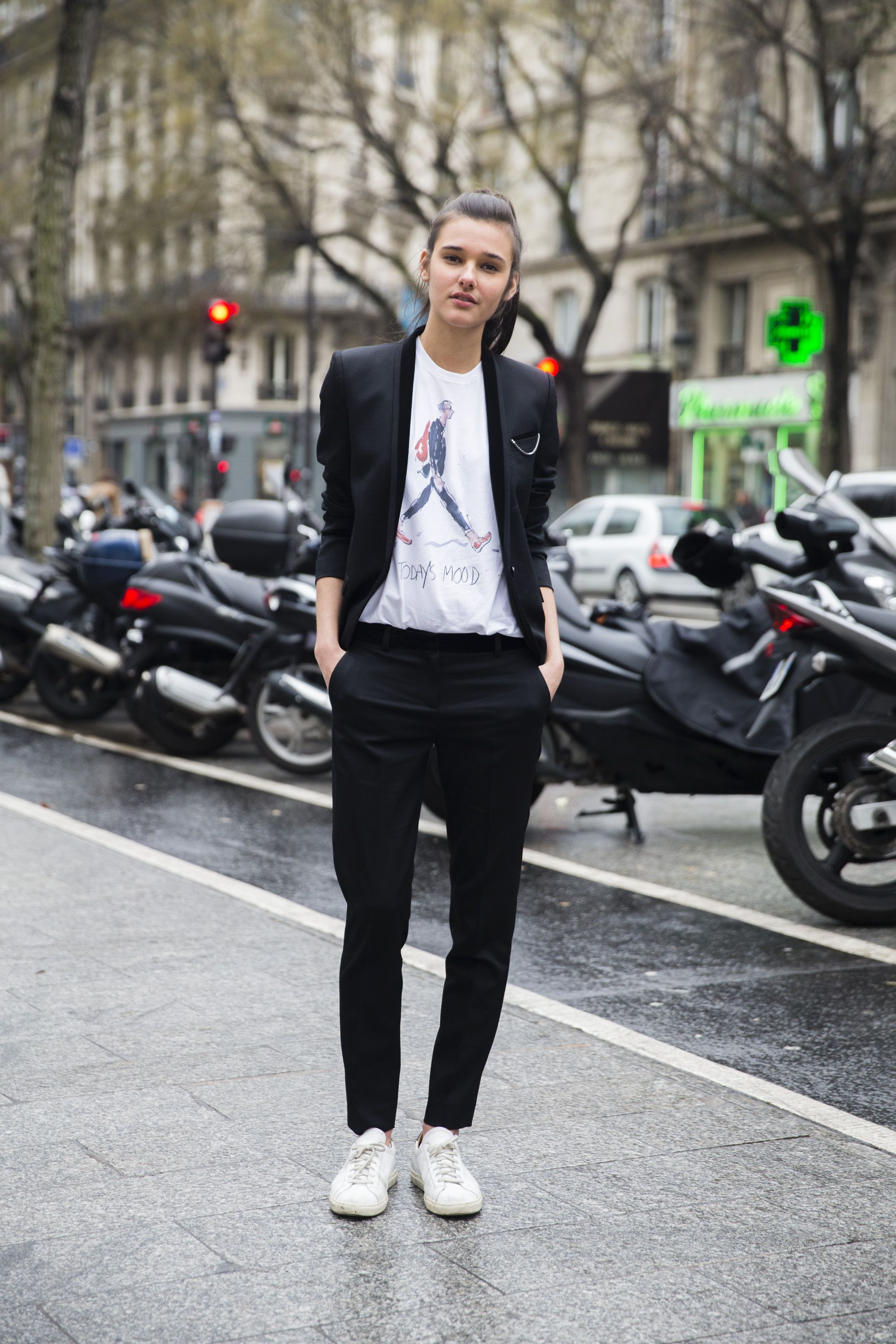 PARIS, FRANCE - JANUARY 23:  Model Jenny Albright wears a slim black Kooples suit with a Richard Haines illustration t-shirt on January 23, 2016 in Paris, France.  (Photo by Melodie Jeng/Getty Images)