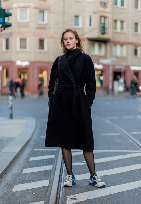 BERLIN, GERMANY - NOVEMBER 5: Latvian model  Margarita Pugovka wearing a black wool coat with belt, tights, black turtleneck sweater, sneakers on November 5, 2016 in Berlin, Germany. (Photo by Christian Vierig/Getty Images)