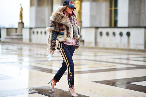Street fashion, Fur, Clothing, Fashion, Jeans, Snapshot, Outerwear, Fur clothing, Footwear, Textile,