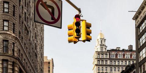 Road, Yellow, Land vehicle, Window, Infrastructure, Street, Neighbourhood, Car, Automotive parking light, Taxi,