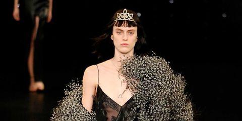 Dress, Fashion model, Fashion, Thigh, Headpiece, Model, Fashion show, Street fashion, Fur, Sunglasses,