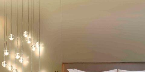 Room, Lighting, Interior design, Property, Bed, Wall, Textile, Bedroom, Bedding, Linens,