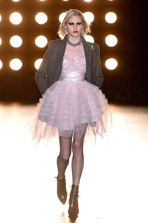 Dress, Textile, Pink, Costume design, Fashion show, Fashion model, Fashion, Costume accessory, Fur, Embellishment,