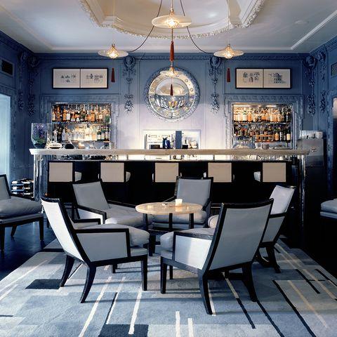 Room, Lighting, Interior design, Floor, Furniture, Light fixture, Ceiling, Ceiling fixture, Interior design, Table,
