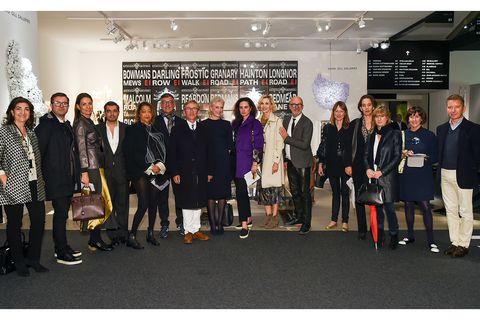 Footwear, Coat, Suit, Team, Blazer, Advertising, Collaboration, Banner, Employment, Hall,