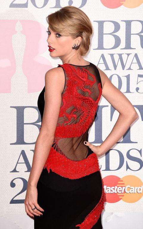 Hairstyle, Shoulder, Joint, Red, Waist, Style, Eyelash, Fashion, Beauty, Fashion model,