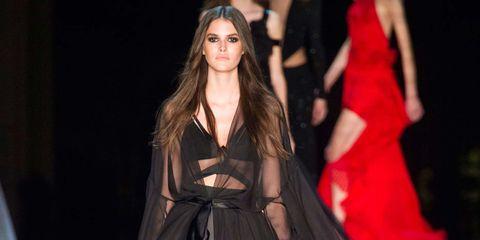 Fashion show, Outerwear, Style, Dress, Runway, Fashion model, Fashion, Costume design, Model, Long hair,