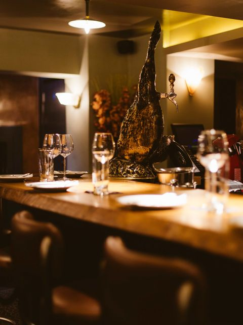 Restaurant, Room, Table, Lighting, Interior design, Dining room, Furniture, Glass, Wine glass, Stemware,