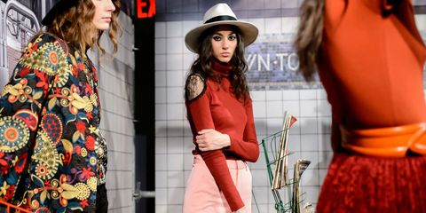Hat, Sleeve, Outerwear, Orange, Style, Fashion accessory, Street fashion, Headgear, Waist, Costume accessory,