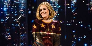 Adele performing on stage - helps a fan propose