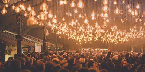 Lighting, Event, Crowd, Orange, Amber, Audience, Light fixture, Electricity, Public event, Festival,