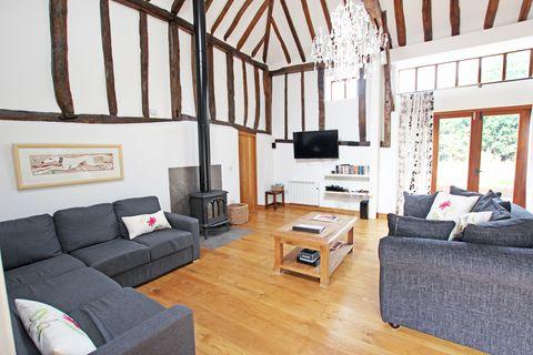 Wood, Room, Interior design, Floor, Living room, Flooring, Table, Home, Hardwood, Couch,