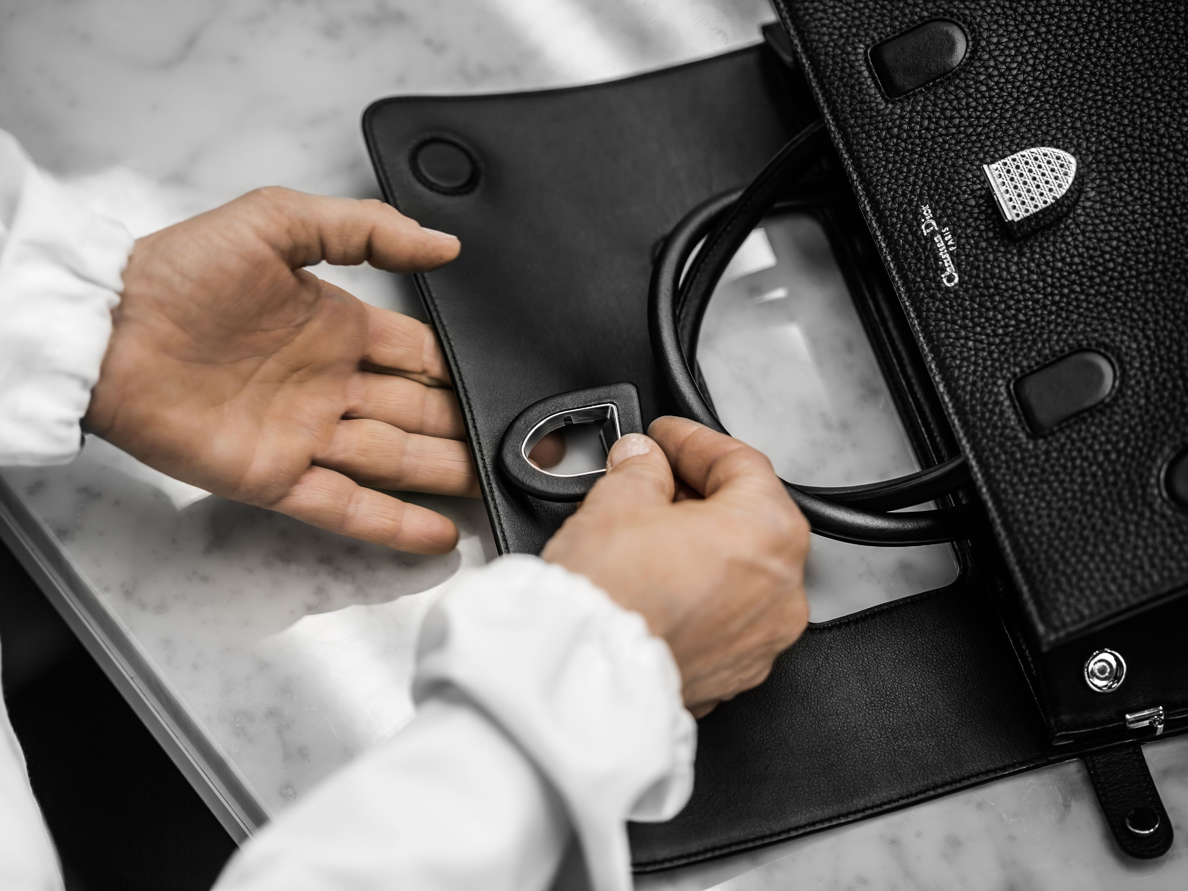 f0c1d46ebf93 Exclusive  watch the making of the new Dior handbag