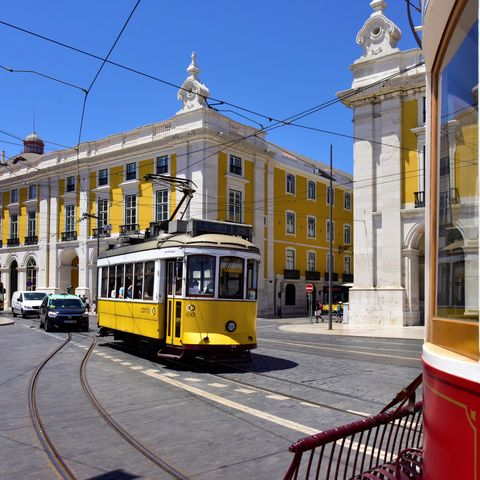 Mode of transport, Transport, Architecture, Rolling stock, Electricity, Tram, Track, Town, Public transport, Landmark,