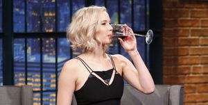 Jennifer Lawrence drinking red wine