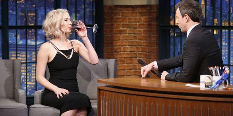 Jennifer Lawrence drinking red wine