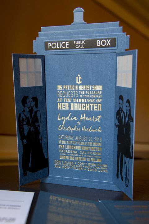 """<p>The unconventional nature to Lydia and Chris' wedding began with the invitation suite, an ode to the Tardis&nbsp;in <em data-redactor-tag=""""em"""" data-verified=""""redactor"""">Dr. Who</em>. Read the fine print: one of the series best-known&nbsp;quotes is etched into the last line of the invitation. The attire?&nbsp;Cocktail &amp; Cowboy Boots.&nbsp;</p>"""