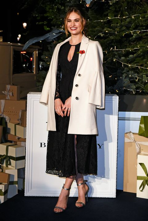 Lily James wearing Burberry at the launch of the Harrods Christmas tree and windows