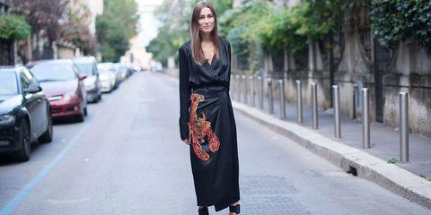 Clothing, Sleeve, Style, Dress, Street fashion, Street, Asphalt, Pattern, Day dress, Automotive lighting,