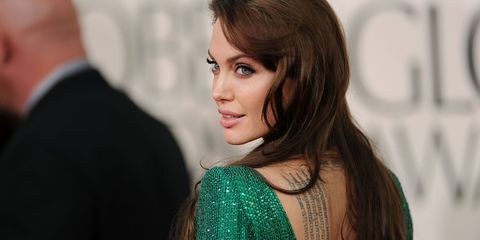 Angelina Jolie in a green dress at the Golden Globes 2011