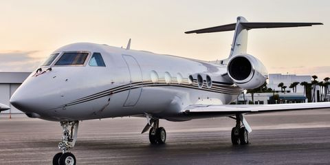 Airplane, Mode of transport, Aircraft, Transport, Automotive tire, Infrastructure, Aviation, Photograph, Jet aircraft, Air travel,