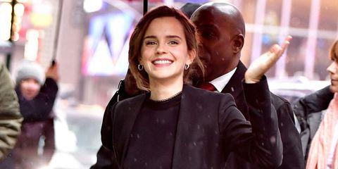 Emma Watson walking in the rain in New York