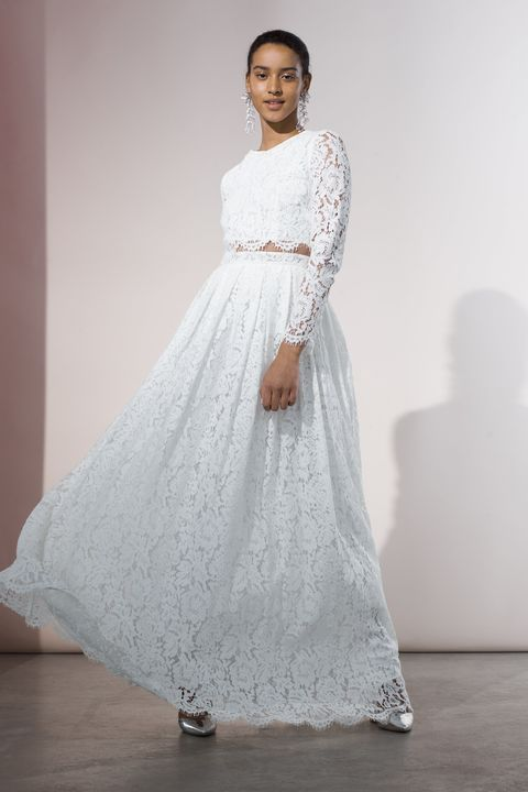 Clothing, Gown, Dress, Wedding dress, White, Fashion model, Shoulder, Bridal clothing, Bridal party dress, Bridal accessory,