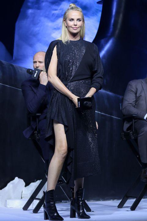 Leg, Human body, Dress, Fashion model, Fashion, Thigh, Little black dress, Long hair, Fashion design, Knee-high boot,