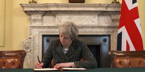 Theresa May signs Brexit letter to the EU