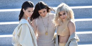 Kendall Jenner, Kim Kardashian and Kylie Jenner at the Yeezy show