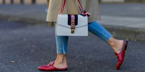 A street styler wearing Gucci backless loafers
