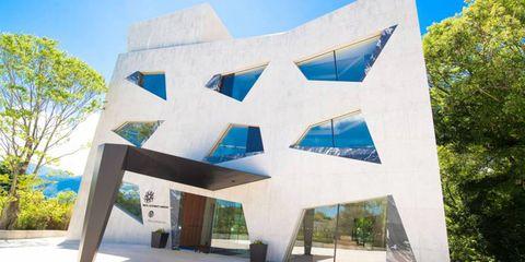 Architecture, Urban design, Facade, Shade, Composite material, Concrete, Design, Headquarters, Brutalist architecture, Shadow,