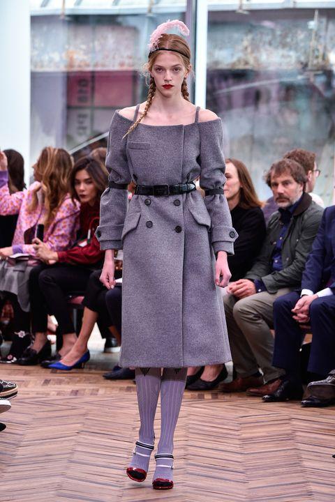 Fashion, Fashion model, Runway, Fashion show, Clothing, Event, Street fashion, Coat, Shoulder, Human,