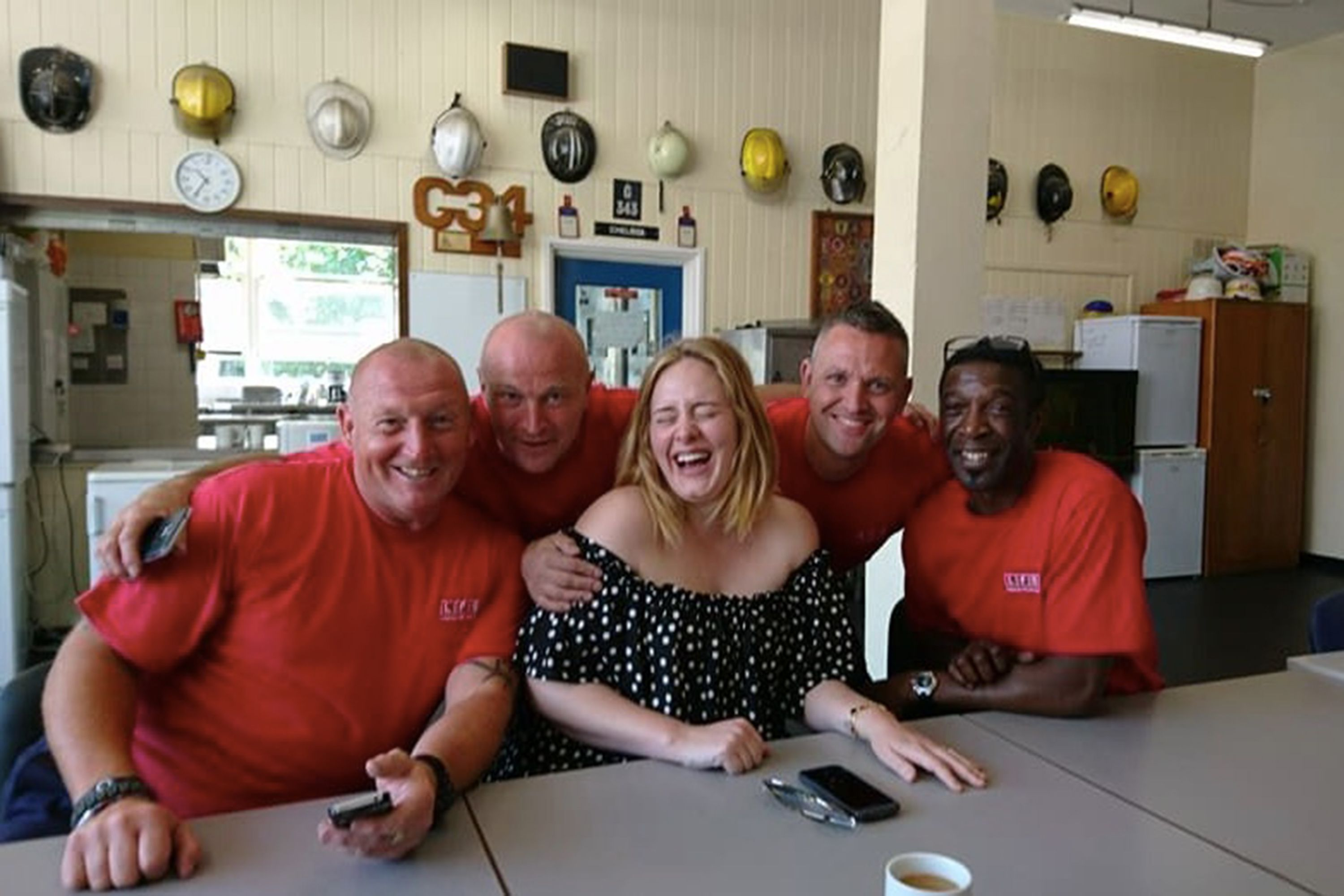 Adele visits Grenfell Tower firefighters for a cup of tea and a cuddle picture