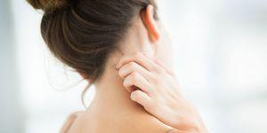 Woman scratching - eczema