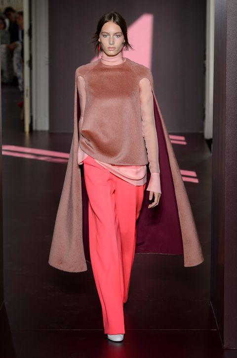 Fashion, Fashion model, Clothing, Fashion show, Pink, Shoulder, Runway, Haute couture, Fashion design, Outerwear,