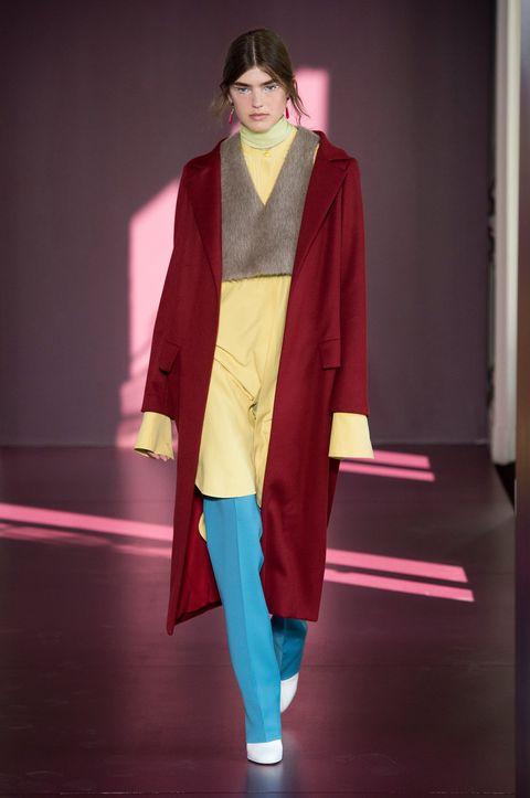 Clothing, Fashion, Fashion show, Runway, Outerwear, Fashion model, Fashion design, Magenta, Haute couture, Costume,