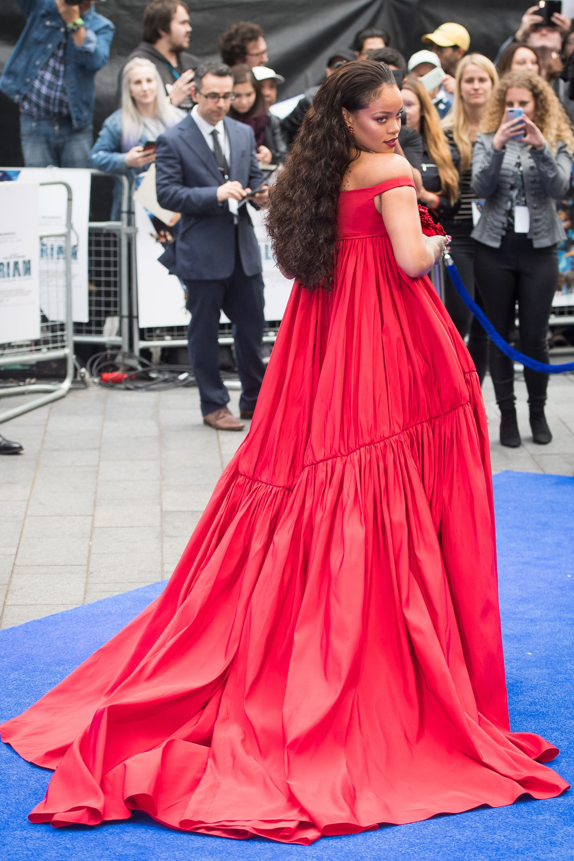Rihanna looks like a regency queen in her giant scarlet gown