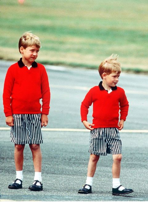 Prince William, Prince Harry Prince William and Prince Harry, wearing identical red jumpers and stripey shorts, arrive at Aberdeen Airport at the start of their holidays in Scotland in August 1989 in Aberdeen, Scotland. (Photo by Anwar Hussein/Getty Images)