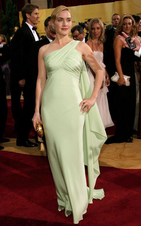 Red carpet, Dress, Carpet, Gown, Shoulder, Clothing, Flooring, Fashion model, Formal wear, Fashion,