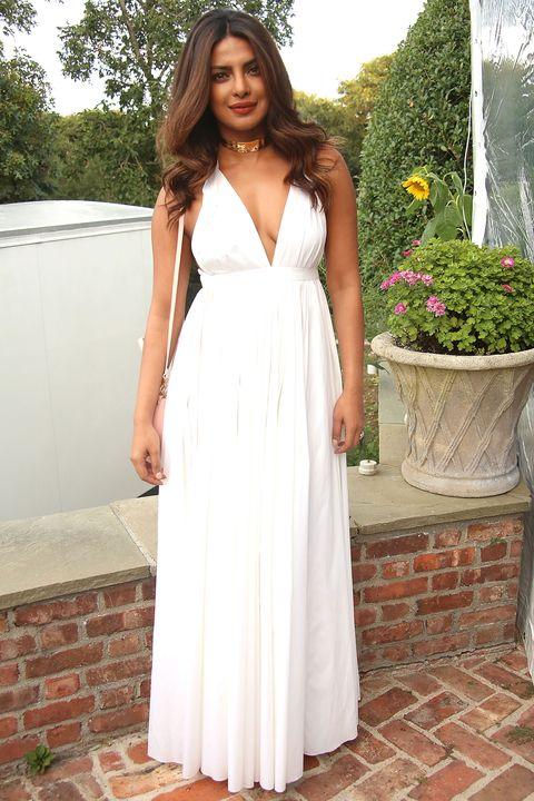 Clothing, Dress, Shoulder, Textile, Bridal clothing, Flowerpot, Formal wear, Gown, Wedding dress, One-piece garment,
