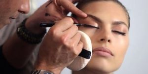 Michael Ashton applying eye make-up