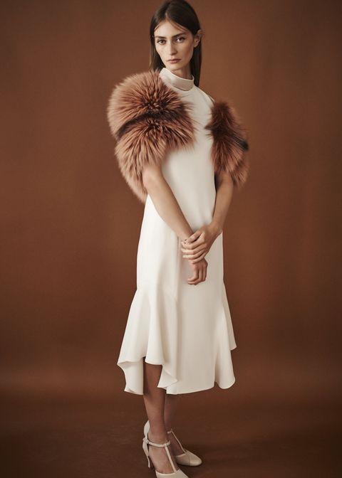Fur, Clothing, Fashion model, White, Fur clothing, Skin, Shoulder, Fashion, Beauty, Outerwear,