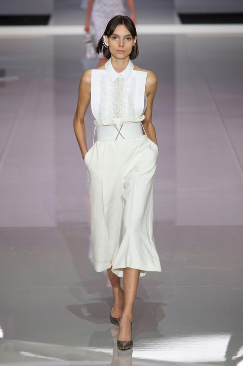 Fashion model, Fashion, Fashion show, Runway, Clothing, White, Dress, Haute couture, Beauty, Waist,