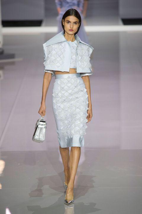 Fashion model, Fashion, Fashion show, White, Runway, Clothing, Shoulder, Haute couture, Waist, Neck,