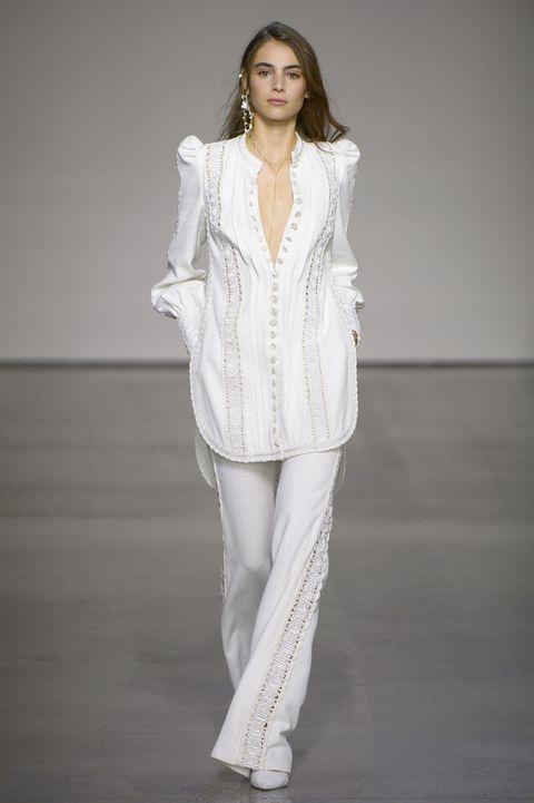 Fashion model, Clothing, White, Fashion, Fashion show, Runway, Outerwear, Neck, Fashion design, Shoulder,