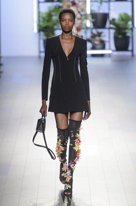 Fashion model, Fashion, Runway, Fashion show, Clothing, Footwear, Shoulder, Joint, Public event, Knee,